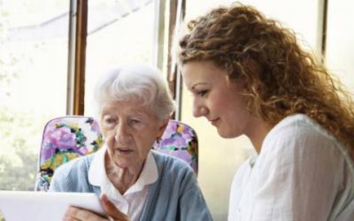 elderly woman and nurse technology