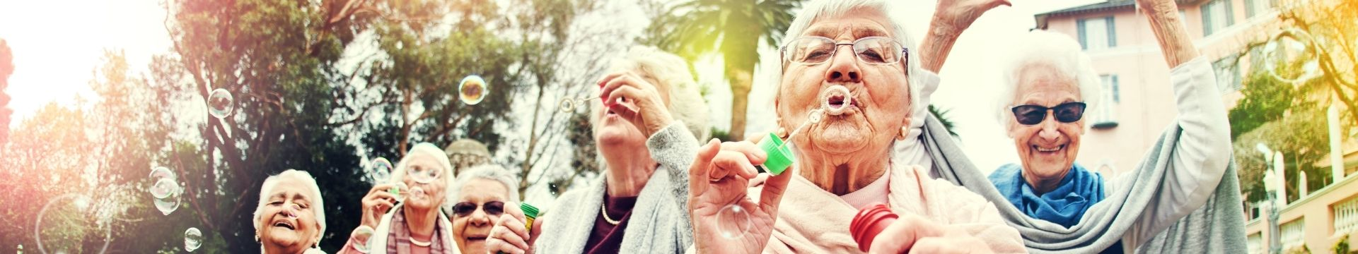 Old ladies blowing bubbles